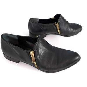 Franco Sarto black shoes with gold zipper detail